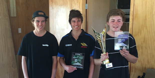 Whanganui High School motocross riders Blake Rountree, James Rountree and Oliver Dennison with their trophy from the Taranaki Secondary Schools championships on Sunday.