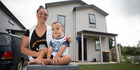 Tania Webb with her 18-month-old son Hercules. Tania and her partner saved $13k in five months on a single income and with eight kids to buy their first home. Photo / Jason Oxenham