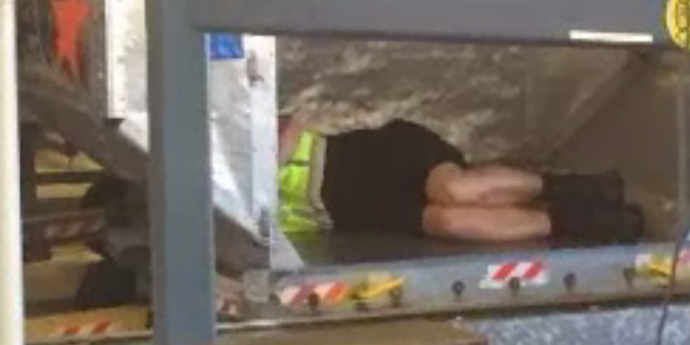 A Sydney Airport worker grabs some sleep. Photo / 730 for ABC