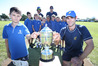 BAY PRIDE: Ryan Douglas, front left, and Peter Drysdale, front right, with the Hawke Cup, Pap Caps players and Bay reps Chris Atkinson, back left, and Tony Goodin, back right. PHOTO: JOHN BORREN