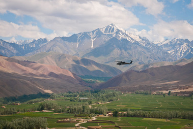 A UH-60 Black Hawk flies over the Bamyan river valley.