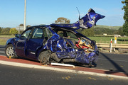 A smashed Toyota Corolla that was hit by a train in Morrinsville today killing the driver. Photo / Natalie Akoorie