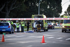 Police and ambulance staff at the scene where an elderly man was fatally struck by a car. Photo/Andrew Warner