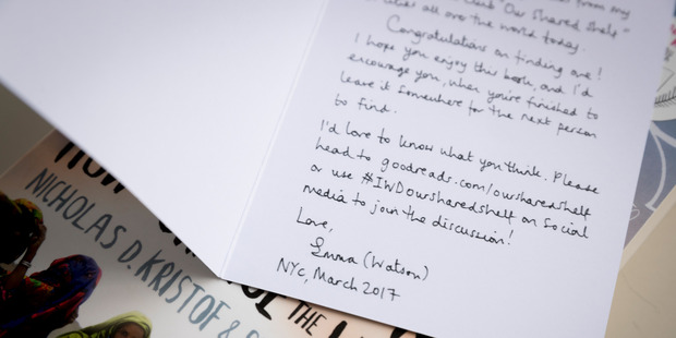 A signed note from actor Emma Watson placed in books for Book Fairy, Jade-Ceres Munoz, to give out. Picture/Dean Purcell.