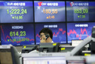 Shares around the world have fallen on concern about blocks to US law changes. Photo / AP