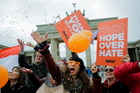 Activists celebrate the election results in the Netherlands in front of the Brandenburg Gate in Berlin. Photo /AP