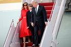 President Donald Trump walks from Air Force One with First Lady Melania and son Barron after arriving at the Palm Beach International Airport. Photo / AP