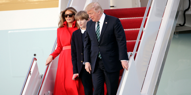 Loading President Donald Trump walks from Air Force One with First Lady Melania and son Barron after arriving at the Palm Beach International Airport. Photo / AP