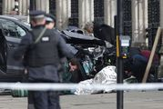 Emergency personnel tend to an injured person close to the Palace of Westminster, London. Photo / AP