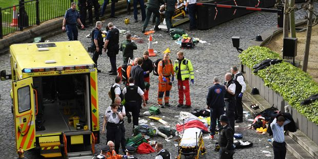 Emergency services at the scene outside the Palace of Westminster. Photo / AP