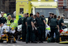 Injured people being tended to by emergency services after the terror attack in London. PHOTO/AP