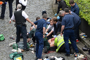 Conservative Member of Parliament Tobias Ellwood, centre, helps emergency services attend to an injured person outside the Houses of Parliament, after a terrorist attack. Photo/AP