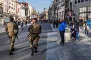 Soldiers patrol the streets of Antwerp after a car drove at high speed through the busy Meir shopping street. Photo / AP