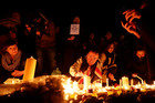 People light candles at a vigil for the victims of yesterday's attack, at Trafalgar Square in London. Photo / AP