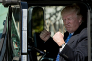 President Donald Trump gestures while sitting in an 18-wheeler truck on the South Lawn of the White House. Photo / AP