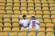Two sevens fans dressed as toffees are surrounded by empty seats at Wellington's Westpac Stadium, prompting the possibility of the event being held elsewhere. Photo/File