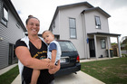 Tania Webb with her 18-month-old son, Hercules, outside their Weymouth home. Photo/Jason Oxenham
