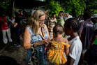 World Vision PNG Country Programme Director Heather MacLeod, a New Zealander, talks with a mother in an informal settlement on the outskirst of Port Moresby. Photo / Mike Scott