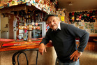 Bruno Clausen in the bar of his Lottin Point motel. Photo / Alan Gibson