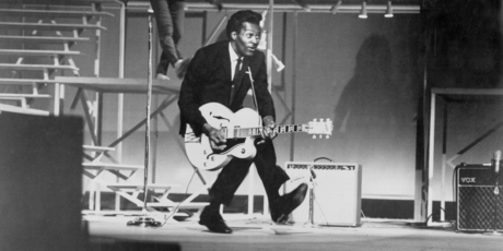 Chuck Berry performs his 'duck walk' in 1964. Photo / AP