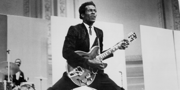 Rock and roll musician Chuck Berry does the splits as he plays his Gibson hollowbody electric guitar in 1968. Photo/ Michael Ochs Archives/Getty Images