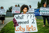 "QUESTIONS: Four-year-old Noah Bishop asks what happened to ""Uncle Colby"" during yesterday's silent protest at Hawke's Bay Prison. PHOTO/PAUL TAYLOR"