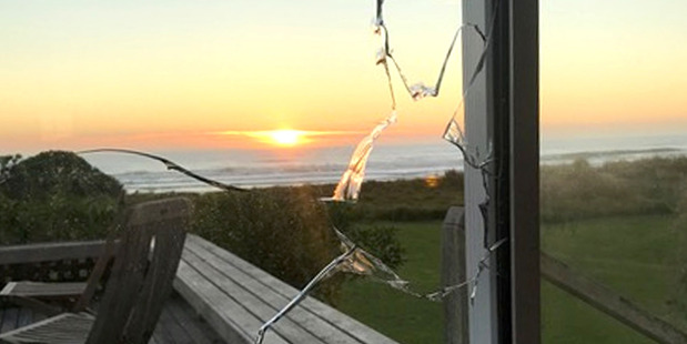 Waimarama residents were woken to rocks being thrown at their houses, with some causing damage, like this broken ranchslider. Photo/Supplied