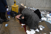 Melissa Cochran is comforted as she lies injured after the attack at Westminster yesterday. Photo / Reuters