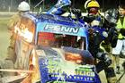Hot Action: Hawke's Bay stockcar driver Regan Penn's car caught fire after he was rolled by clubmate Hayden Barnett on Saturday night. Photo/Andrew Brunton