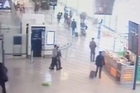 CCTV footage from the Paris Orly Airport attack shows a soldier caught by surprise when the attacker drops a shopping bag and grabs her from behind.