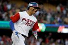 Puerto Rico's Carlos Correa celebrates a two-run home run against the Netherlands. Photo / AP