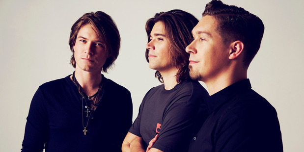 Hanson are bringing their 25th anniversary world tour to New Zealand in June. Photo / supplied