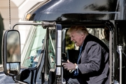 Donald Trump is not above trying to entertain a crowd, as he showed when pretending to drive an 18-wheeler during a meeting with truckers and CEOs on the South Lawn of the White House yesterday. Photo / AP