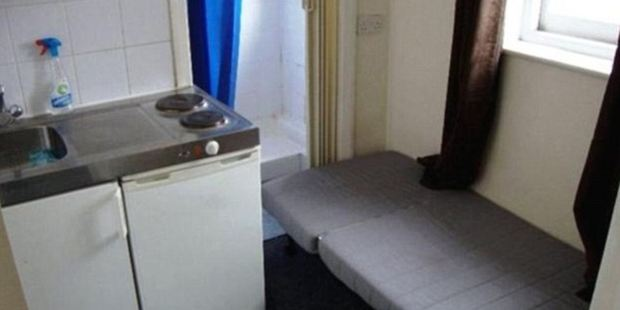The toilet is just inches from the bed in this tiny London studio flat. Photo / RightMove