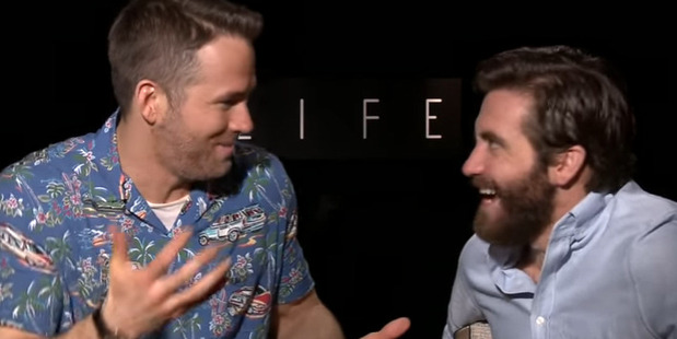Ryan Reynolds and Jake Gyllenhaal fail to keep it together during interview. Photo / YouTube