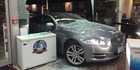The Jaguar bowled through the front of Mobil around 5.40am. Photo / Sarah Harris