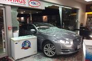 The Jaguar bowled through the front of Mobil around 4.40am. Photo / Sarah Harris