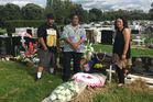 Great-nephew Alex Teio, nephew Paul Teio and niece Annie Bourke at the grave of their aunt, Sameme Fred. Photo / Cherie Howie