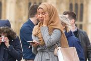 The Muslim woman who was photographed looking at her phone while walking across Westminster Bridge has today hit back at trolls. Photo: REX/Shutterstock