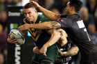 Darius Boyd tackled by Shaun Johnson during the trans-Tasman test between New Zealand and Australia. Photo/Photosport