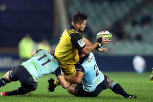 Chris Eves offloads from the tackle against the Waratahs. Photosport