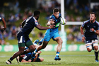 Blues wing Matt Duffie on his way to scoring his first try against the Bulls at QBE Stadium. Photo / Photosport