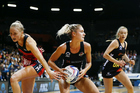 Ariana Cable-Dixon of the Magic competes against Hayley Saunders of the Tactix. Photo / Photosport