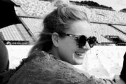 Adele at Mt Smart stadium on Saturday, grinning from behind a pair of Karen Walker sunglasses. Photo/ Instagram