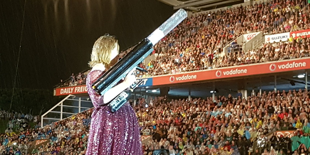 Adele fires a T-shirt into the crowd using a cannon at Mt Smart Stadium in Auckland.