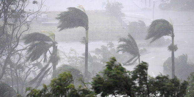 Loading Strong winds and rain lash Airlie Beach. Photo / AAP
