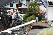 Locals inspect the damage at Shute Harbour, Airlie Beach. Photo / AAP