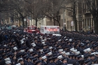 Uniformed firefighters fill the street as an ambulance carries the body of fallen New York medic Yadira Arroyo. Photo / AP