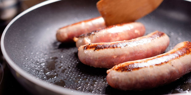 The sausages should be left over the heat for 30 minutes with a knob of unsalted butter and turned occasionally to ensure they are cooked evenly. Photo / 123RF