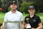 Mark Hutson and Amelia Garvey with their spoils after claiming the men and women's NZ Strokeplay Championship crowns in Hastings yesterday. PHOTO/www.bwmedia.co.nz